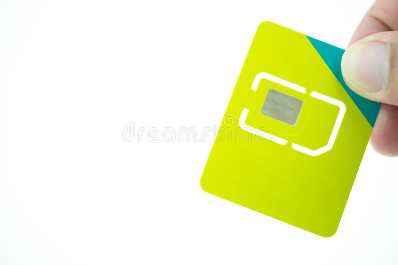 Hand and phone sim card stock image