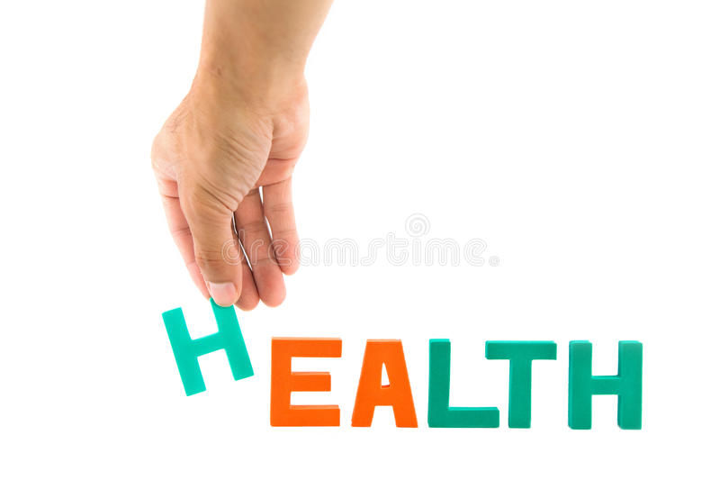 Hand pick up H alphabet from health wording