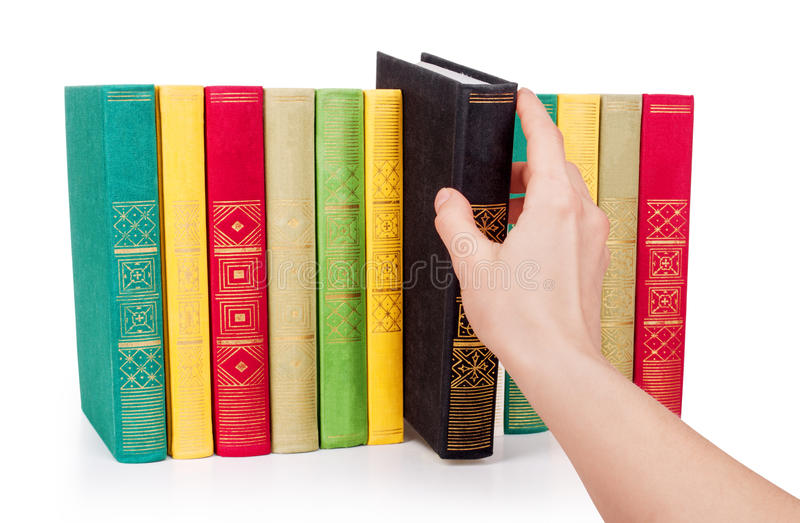 Hand picking book in library. Isolated royalty free stock photo