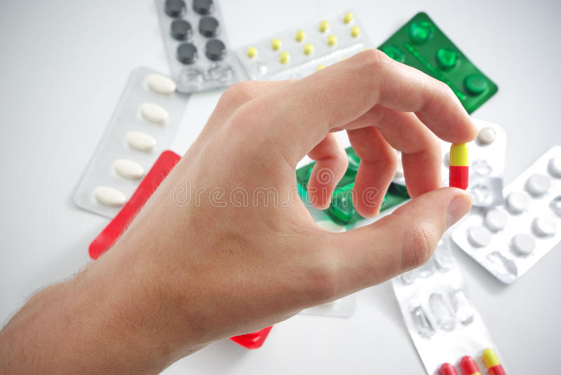 Hand with pill stock photos
