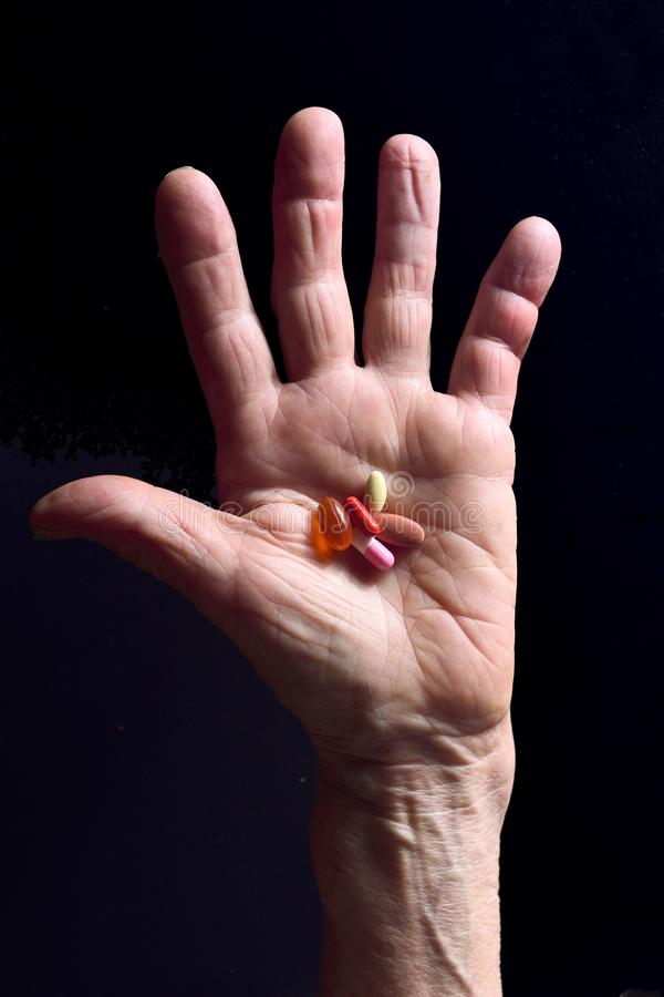 Hand and pills senior woman royalty free stock photo