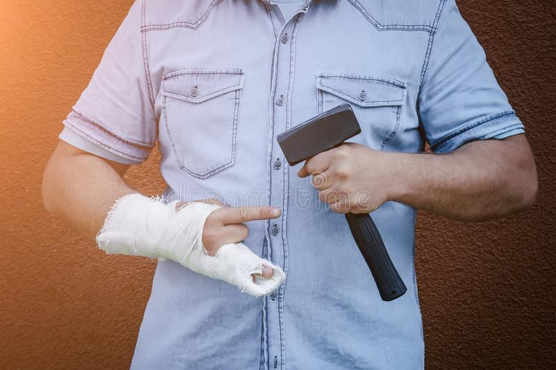 Hand in plaster from a blow with a hammer.  royalty free stock photos