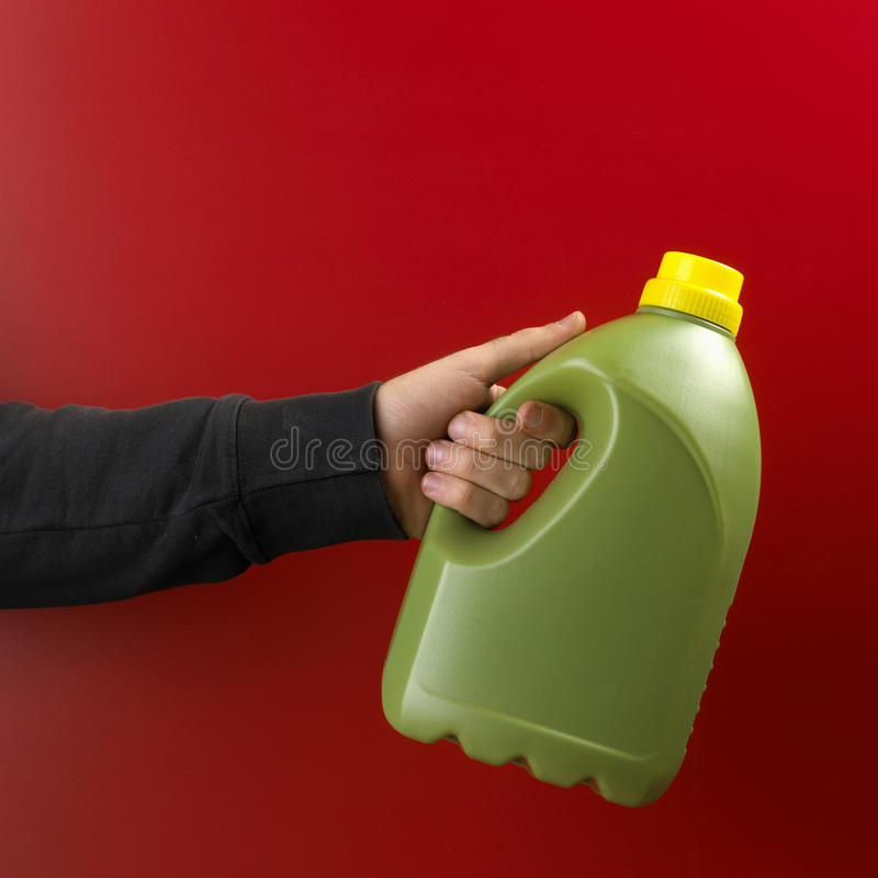 Hand with plastic bottle royalty free stock images