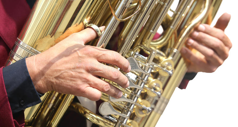 Hand of player and the saxophone. Hand of player and the golden saxophone stock photography