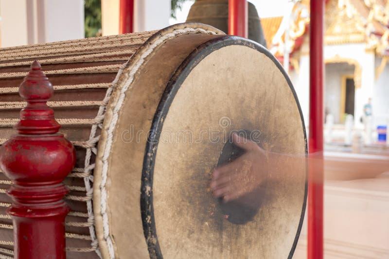 Hand that plays drum. Wat Benchamabophit Dusitvanaram, marble temple, bangkok thailand stock image