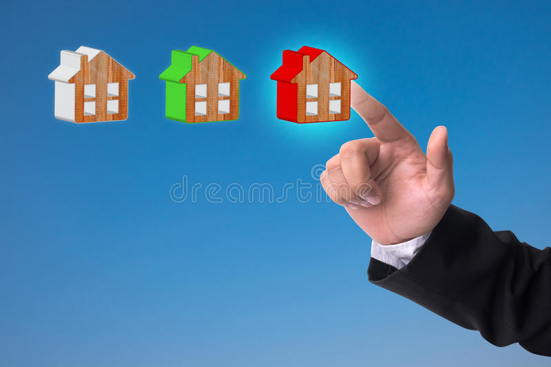 Hand point at the red home model. Real estate concept stock photography