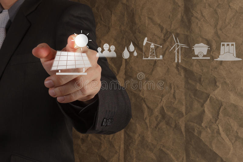Hand point solar cell icon with crumpled recycle paper background. As concept stock photography