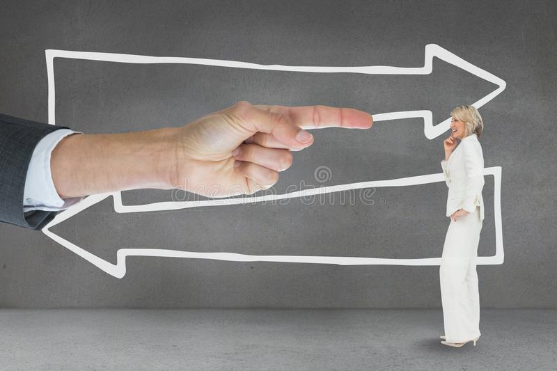 Hand pointing at business woman against grey background with arrows stock photo