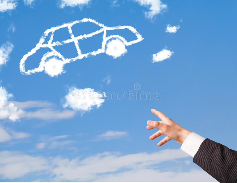Hand pointing at car cloud on a blue sky. Hand pointing towards at a car cloud on a blue sky royalty free stock image