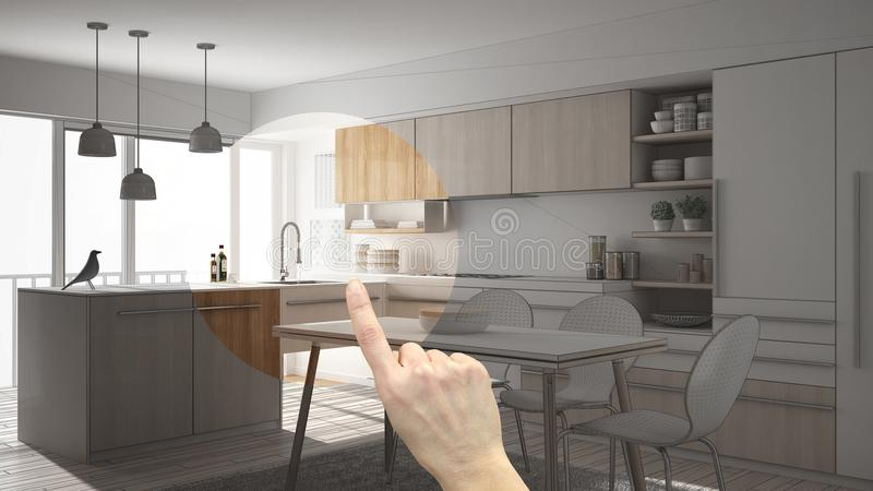 Hand pointing interior design project, home project detail, deciding on rooms furnishing or remodeling concept, modern minimalisti. C wooden kitchen with dining royalty free stock image