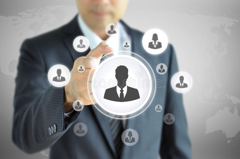 Hand pointing to businessman icon - HR & recruitment concept royalty free stock photography