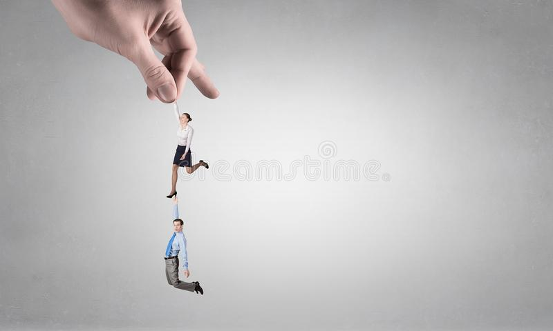 Hand of power and control . Mixed media stock photos