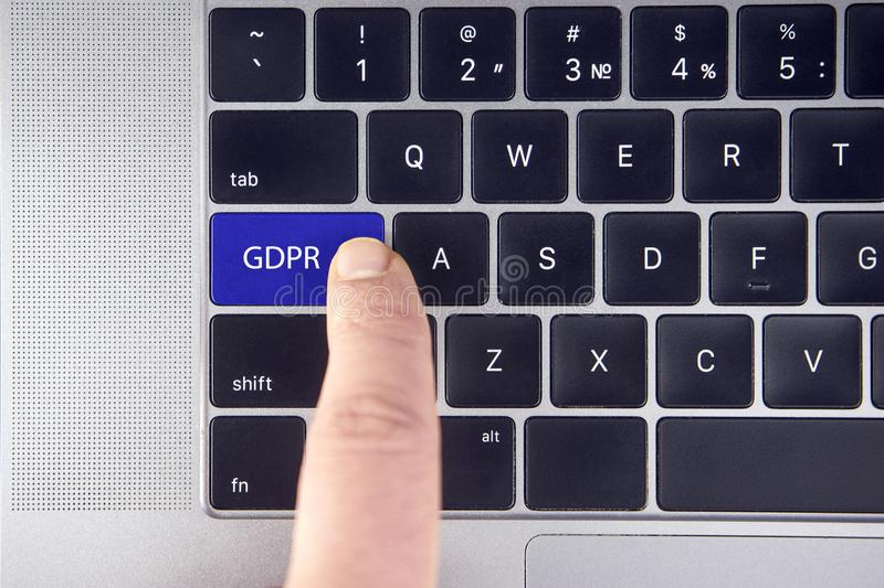 Hand press the button GDPR on keyboard laptop royalty free stock photo