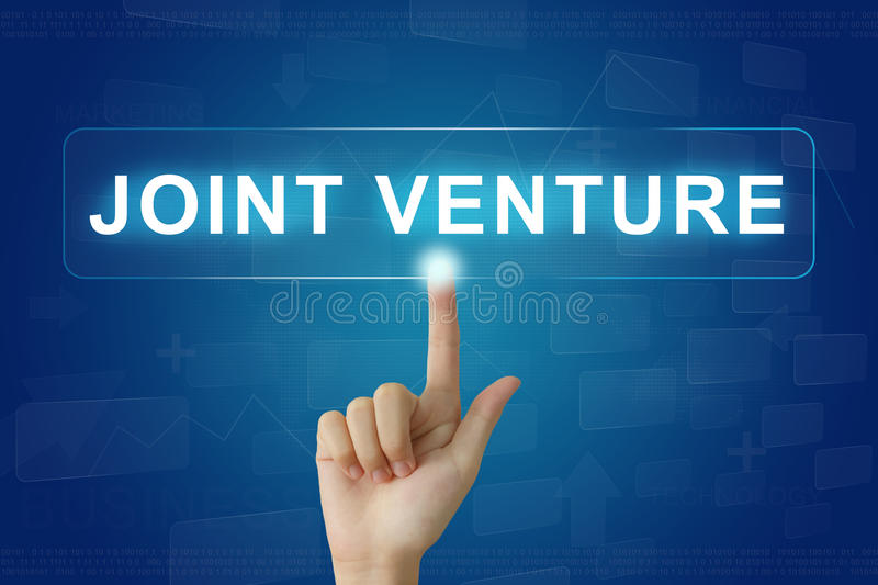 Hand press on joint venture button on touch screen royalty free stock photography