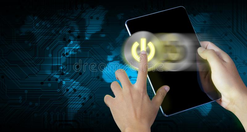 Hand press power button on a digital tablet screen royalty free stock images