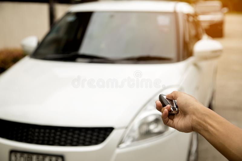 Hand press remote car.Concept finance. stock image