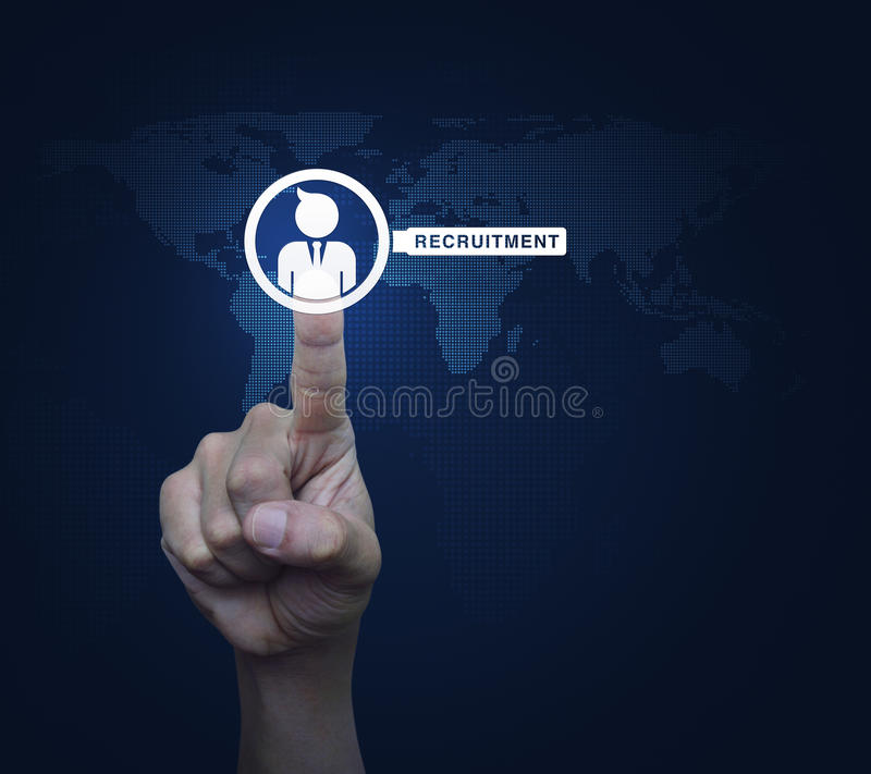 Hand pressing businessman with magnifying glass icon over digital world map, Recruitment concept, Elements of this image. Furnished by NASA royalty free stock images