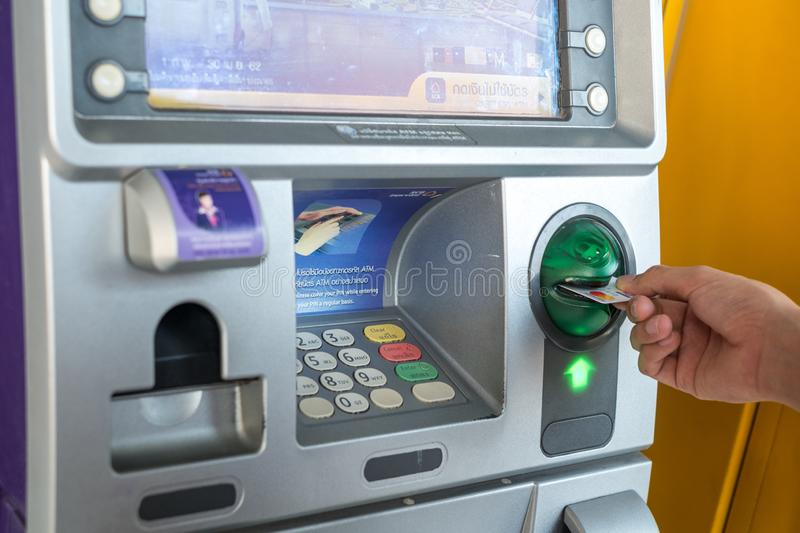 Hand pressing the code from the ATM focuses on the numbers and the finger area stock photography