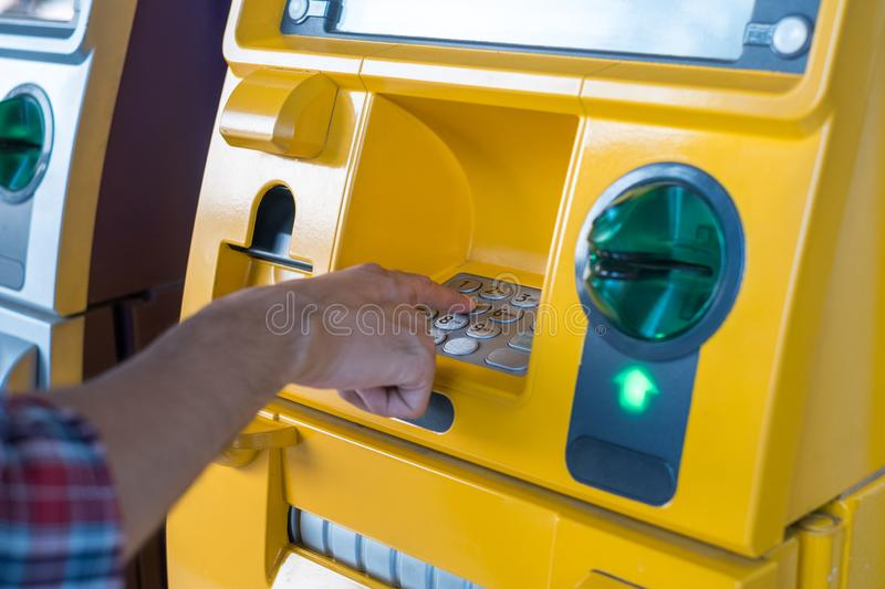 Hand pressing the code from the ATM focuses on the numbers and the finger area.  royalty free stock photos