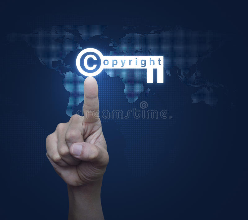 Hand pressing copyright key icon over digital world map technolo. Gy style, Copyright and patents concept, Elements of this image furnished by NASA stock images