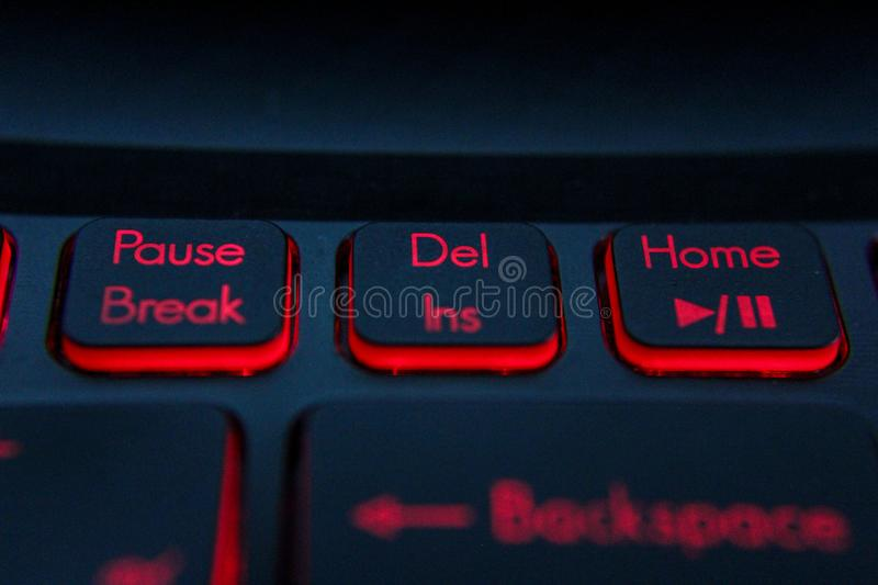 Hand pressing `enter``Del` `Backspace` button on computer and Red LED - Image stock image
