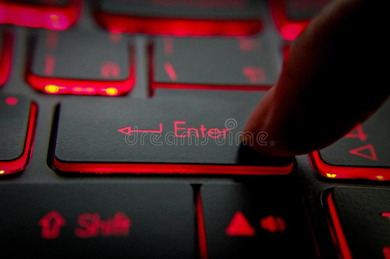 Hand pressing `enter``Del` `Backspace` button on computer and Red LED - Image. Hand pressing `enter``Del` `Backspace` button on computer and Red LED royalty free stock image