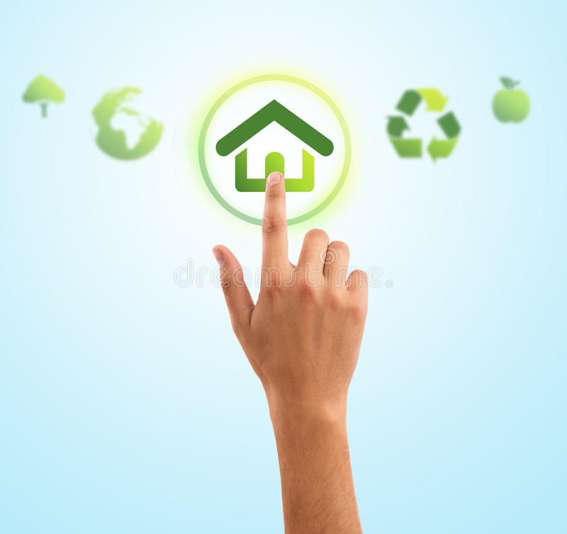 Hand pressing home symbol from eco green icons royalty free stock image