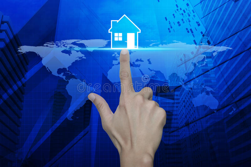 Hand pressing house icon with over map and city tower, Real esta. Te concept, Elements of this image furnished by NASA royalty free stock image