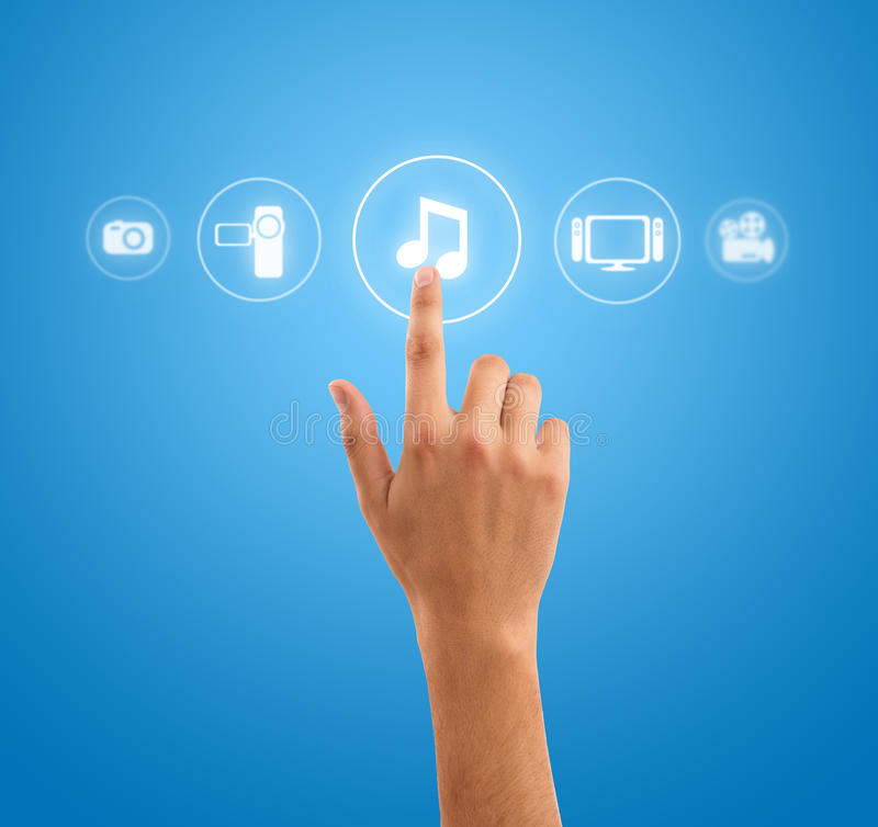 Hand pressing music note symbol from media icons royalty free stock images