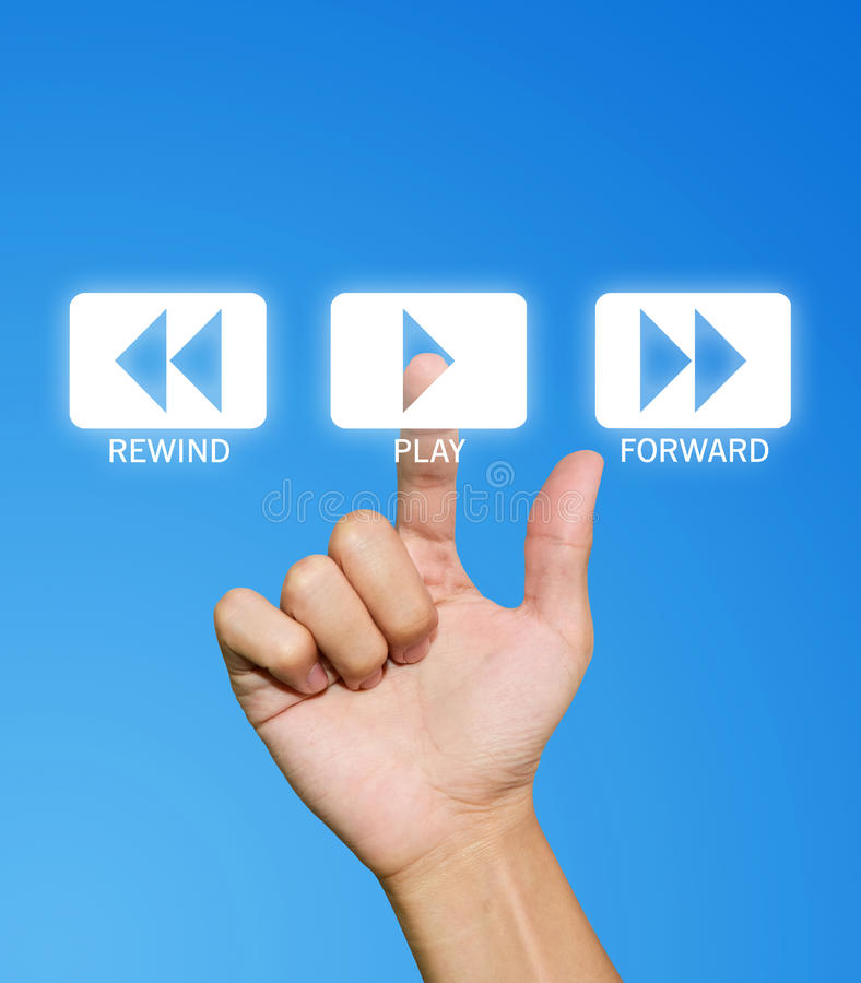 Hand pressing play button. On the blue background stock photography