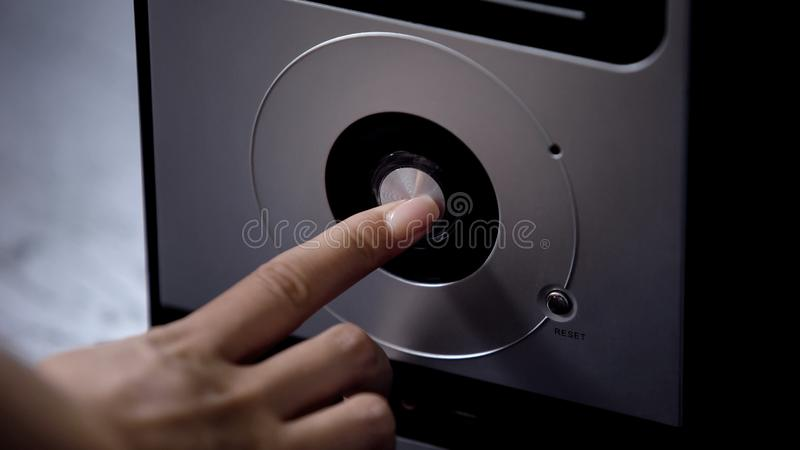Hand pressing power button system block, modern personal computer technology. Stock photo stock photo
