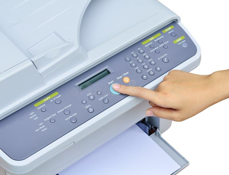 Hand pressing Start button. On printer stock image