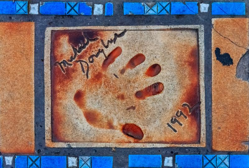 Hand print of Michael Douglas on the Cannes Walk Of Fame. Cannes, France - October 18, 2013: Hand print of Michael Douglas on the Cannes Walk Of Fame royalty free stock images