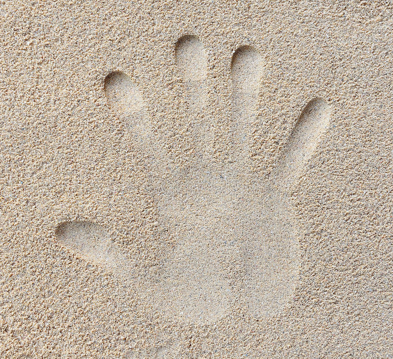 Hand print in sand royalty free stock image