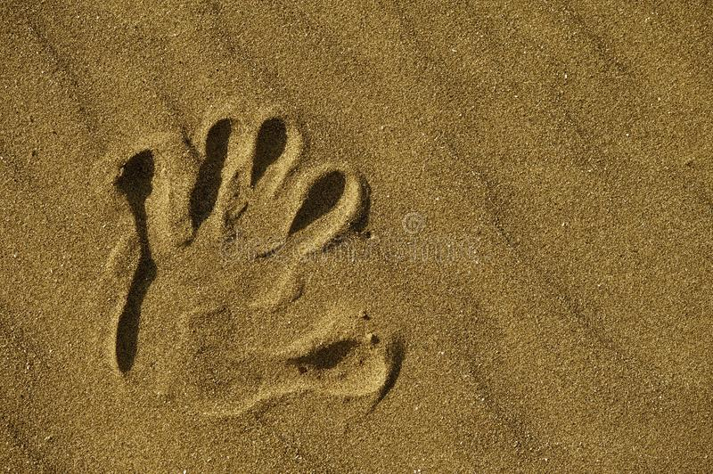 Hand Print in Sand stock photos