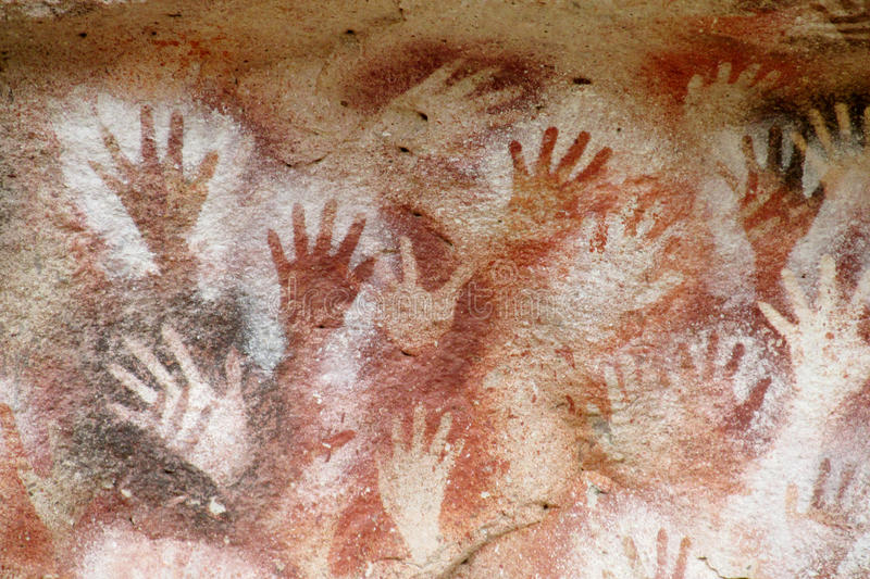 Hand prints on a cave wall cueva de las manos. Cave of Hands in Argentina, cueva de las manos. Cave with hand arm prints on the walls. Handprints made with red royalty free illustration
