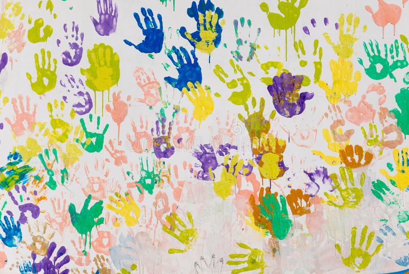 Hand prints. Wall covered with colorful hand prints royalty free stock images