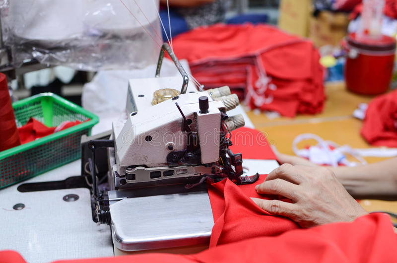 Hand of professional sewing machine stock image