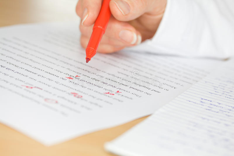 Hand Proofing a Transcribed Page. Proofreader with red pen checks a transcription of some hand written text royalty free stock images