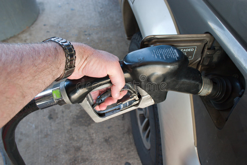 Hand Pumping Gas Fuel stock photography