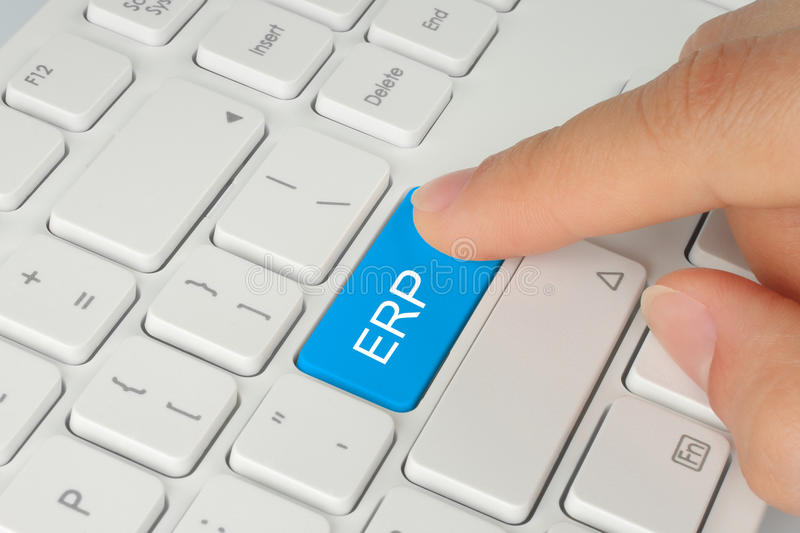 Hand pushing blue ERP button stock photography