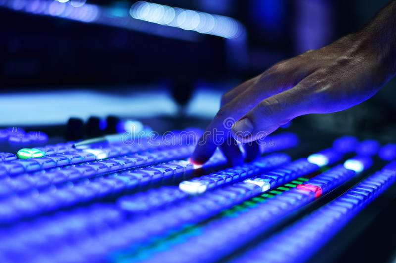 Hand Pushing Buttons on Video Mixer royalty free stock photo