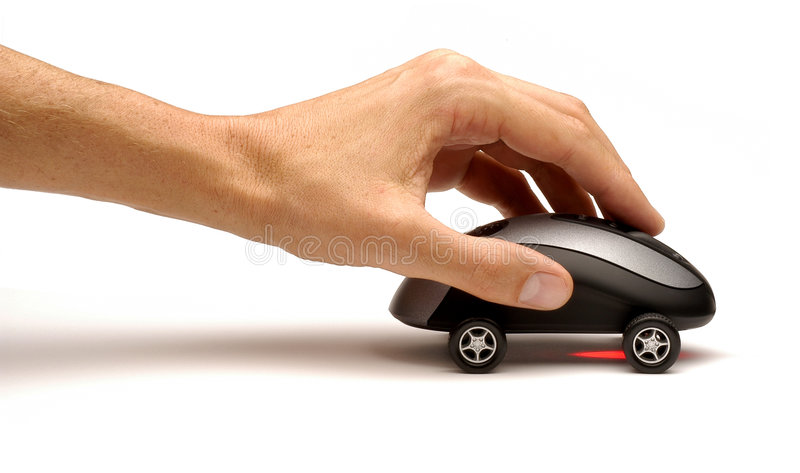 Hand Pushing Computer Mouse Car. Hand pushing computer mouse with wheels on it