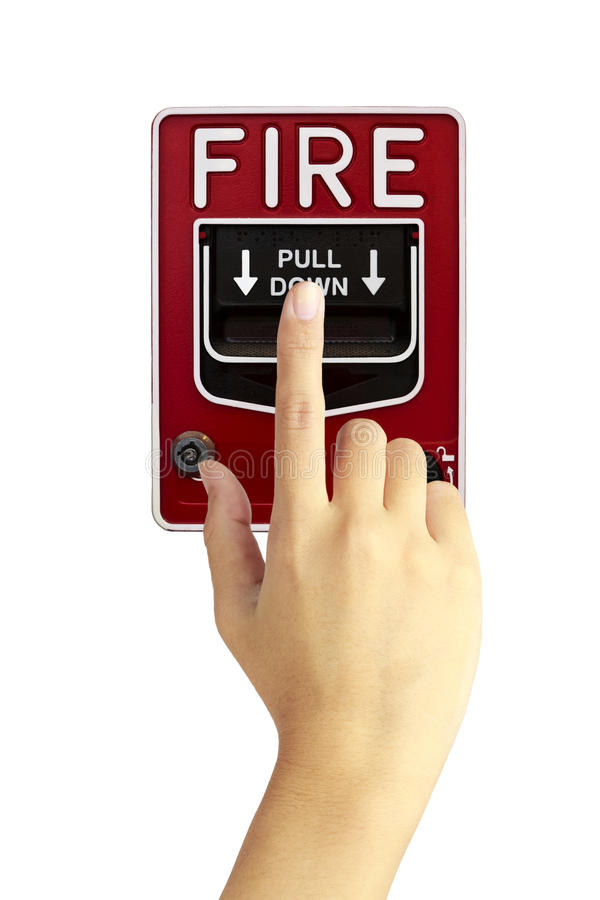 Hand is pushing fire alarm switch royalty free stock image