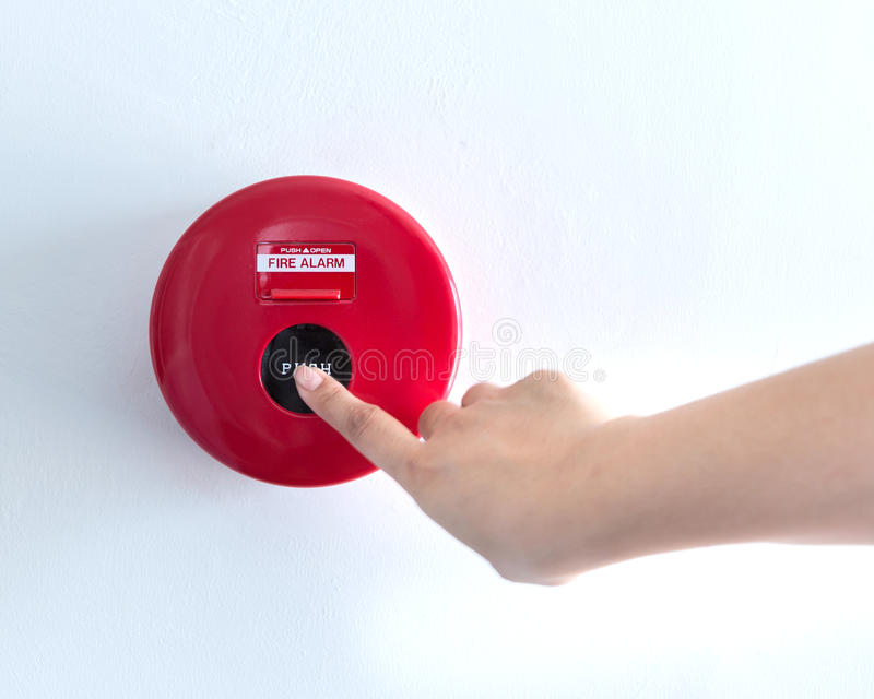 Hand is pushing fire alarm switch royalty free stock photos