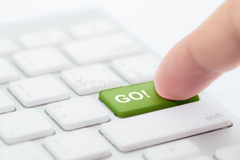 Hand pushing go green button stock photos
