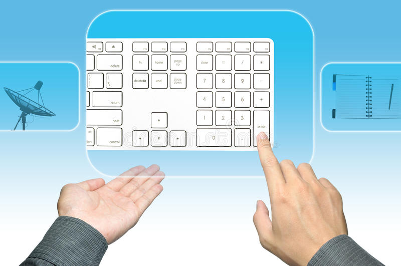 Hand pushing keyboard on a touch screen interface royalty free stock photos
