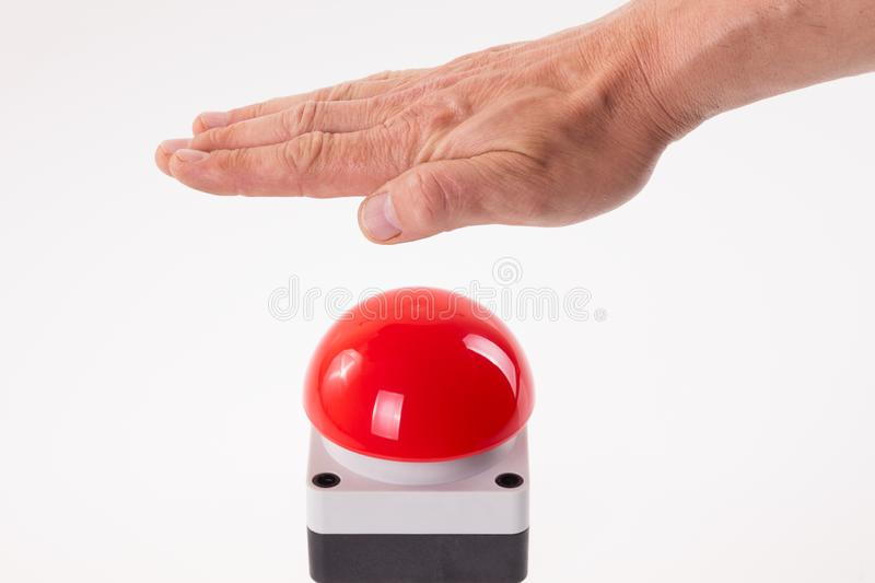 Hand pushing a red buzzer stock photos