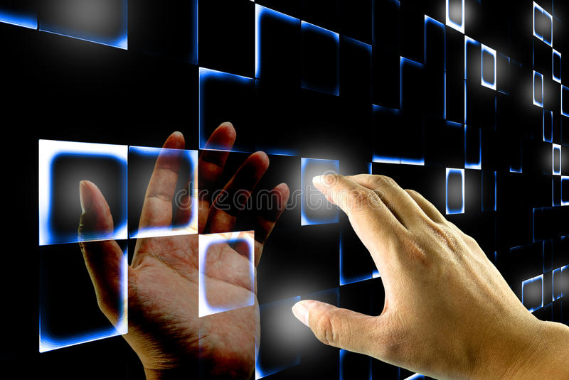 Hand pushing on a touch screen. A hand pushing on a touch screen interface with reflection of other hand royalty free stock photos