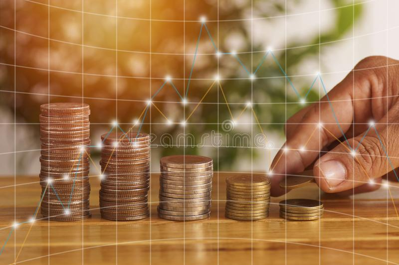 Hand put money pile of coins, concept in growth, save and investment. In business royalty free stock image